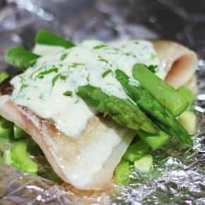 Steamed cod parcels with asparagus & lemon parsley sauce